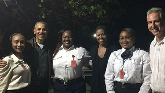 The couple posed with immigration officials in the British Virgin Islands.