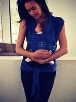 Model mum Megan Gale matches her outfit with her baby carrier. Picture: Instagram