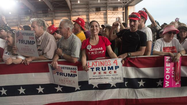 Supporters cheer US President Donald Trump during the rally at the Orlando Melbourne International Airport. Picture: AFP