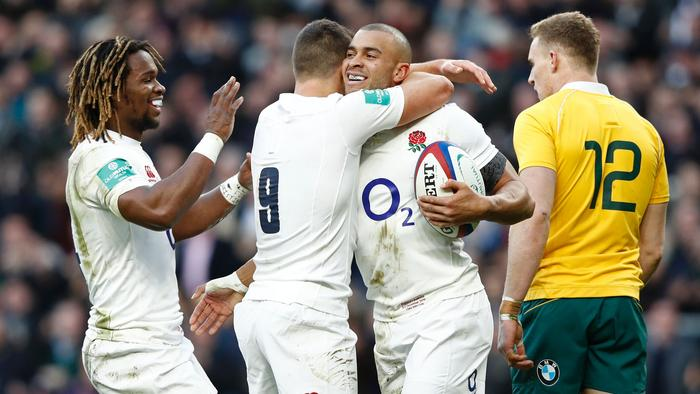 England's centre Jonathan Joseph (2nd R) celebrates with England's scrum half Ben Youngs (2nd L) and England's wing Marland Yarde (L) after scoring a try during the international rugby union test match between England and Australia at Twickenham stadium in south-west London on December 3, 2016. / AFP PHOTO / Adrian DENNIS