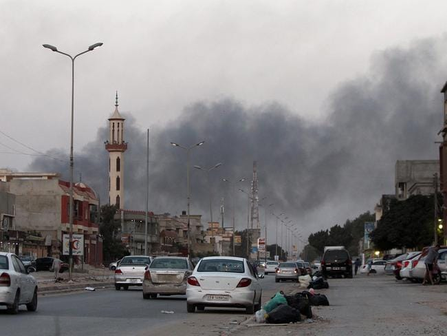 Portents of trouble ... smoke billows from buildings during clashes between Libyan security forces and armed Islamist groups in Benghazi. Picture: AFP PHOTO / ABDULLAH DOMA