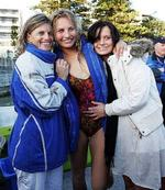 <p>Lauryn Eagle with her mother Kerri, left, and her sister Sarah, right, at Manly Wharf after her record breaking attempt to water ski to Newcastle and back today. Photo: Justin Lloyd</p>