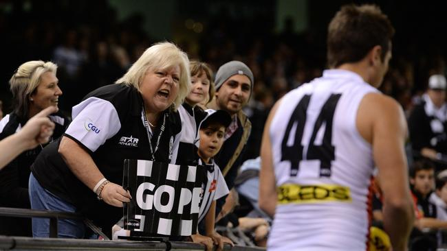 Collingwood fans give it to Stephen Milne as he lines up for goal.