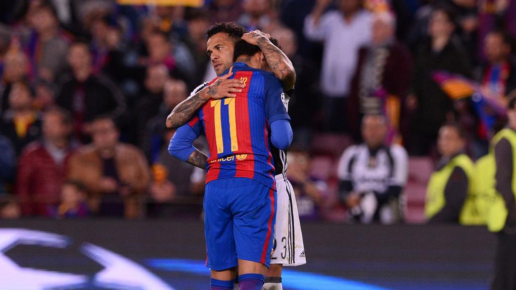Barcelona's Neymar is comforted by Juventus' Dani Alves.