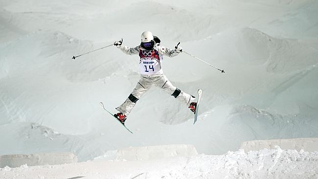 Japan's Junko Hoshino jumps during a moguls training session at the Rosa Khutor Extreme Park.