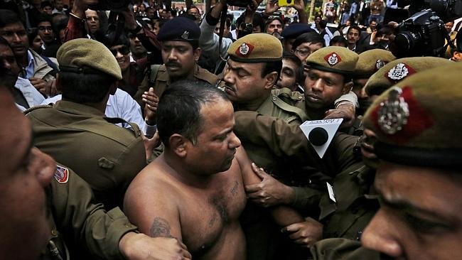 Arrest...Policemen detain lawyer Manoj Sharma after he threw ink on Chairman of Sahara India, Subrata Roy outside the Supreme Court in New Delhi. Picture: AP