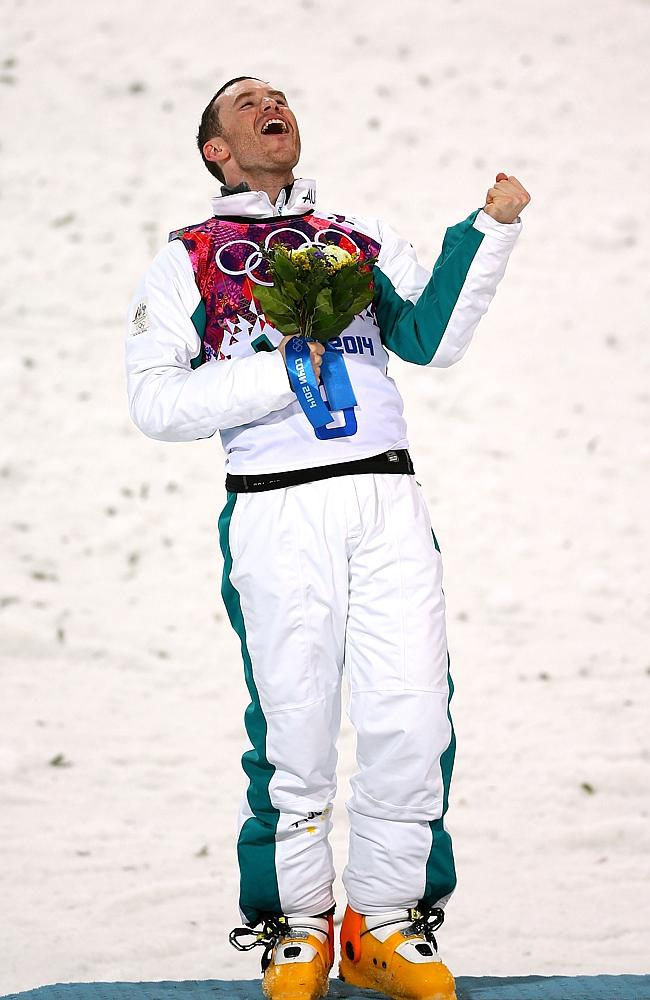 Silver medallist David Morris of Australia celebrates during the flower ceremony for the Freestyle Skiing Men's Aerials Finals.