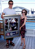 <p>The long and short of it ... presenting Kylie Minogue with a platinum record in 2000 / Image supplied</p>