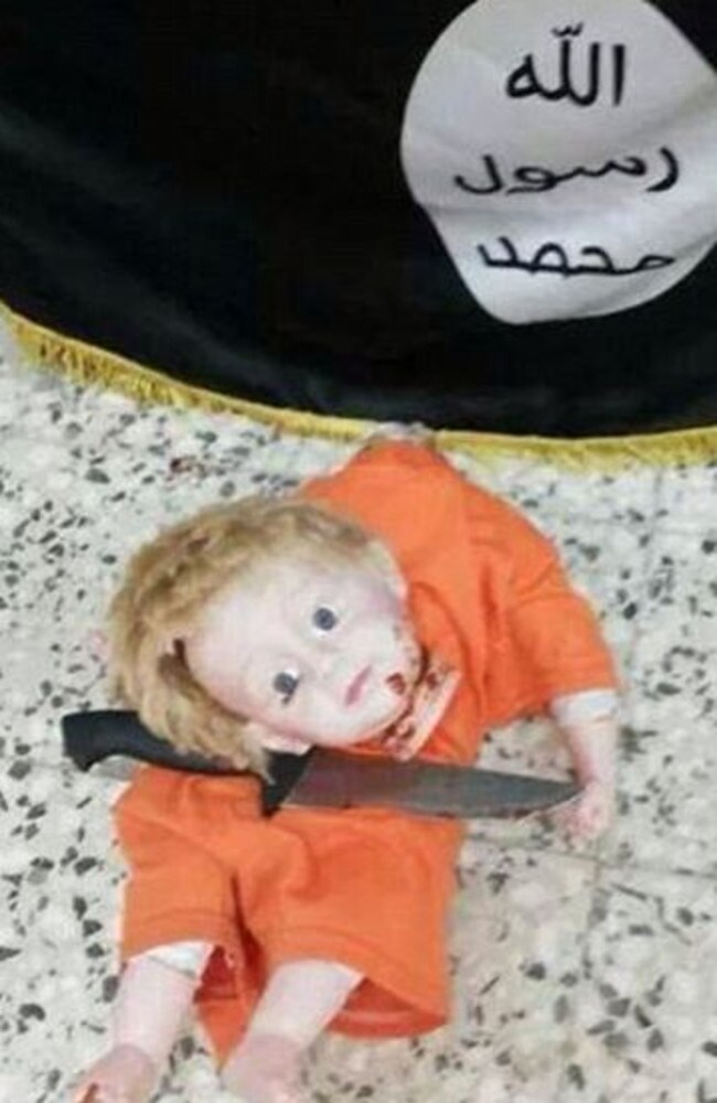 Designed to provoke ... the second image shows a bloodied knife next to the doll's head. Picture: Twitter