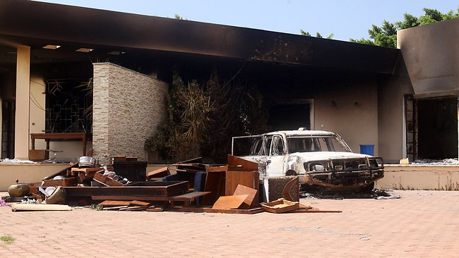 A burnt car after an attack on the U.S. Consulate by protesters angry over a film that ridiculed Islam's Prophet Muhammad in Benghazi, Libya. The U.S. ambassador to Libya and three other Americans were killed. AP / Ibrahim Alaguri