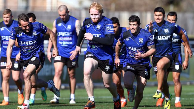 Josh Reynolds, James Graham and Michael Ennis race during a Canterbury training session.