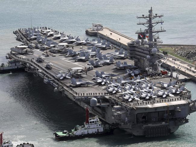 The aircraft carrier USS Ronald Reagan (CVN 76) is escorted into Busan port, South Korea, after completing a joint drill with the South Korean military. Picture: AP