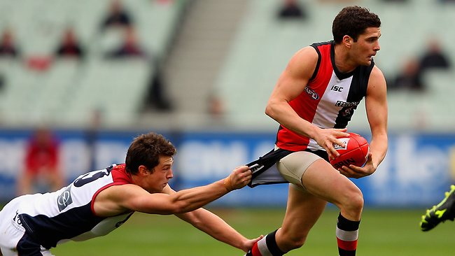 MELBOURNE, AUSTRALIA - AUGUST 11: Leigh Montagna of the Saints is tackled by James Strauss of the Demons during the round 20 AFL match between the St Kilda Saints and the Melbourne Demons at the Melbourne Cricket Ground on August 11, 2012 in Melbourne, Australia. (Photo by Robert Prezioso/Getty Images)