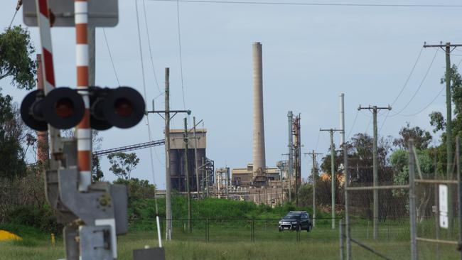 Workers leave the Queensland Nickel refinery at Yabulu near Townsville on Friday, not knowing if they'll be back. Picture: AAP Image/Andrew Rankin