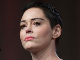 US actress Rose McGowan gives opening remarks to the audience at the Women's March / Women's Convention in Detroit, Michigan, on October 27, 2017. A stream of actress including Rose McGowan, models and ex-employees have come out, many anonymously, to accuse Hollywood producer Harvey Weinstein of sexual harassment and abuse dating as far back as the 1990s. / AFP PHOTO / RENA LAVERTY