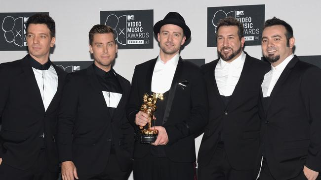 `NSync reunite in 2013, and Justin naturally gravitates to the centre. Picture: Getty