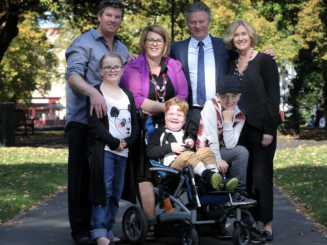 Jeffrey and Rebecca Kitchin, of Scottsdale, with Steve and Lynette Waugh and, front from left, the Kitchins' children Nakita, 9, Xavier, 5, and Darcy, 8. Little Xavier is one of several Tasmanians who have received a grant from the Steve Waugh Foundation. Pictures: LUKE BOWDEN