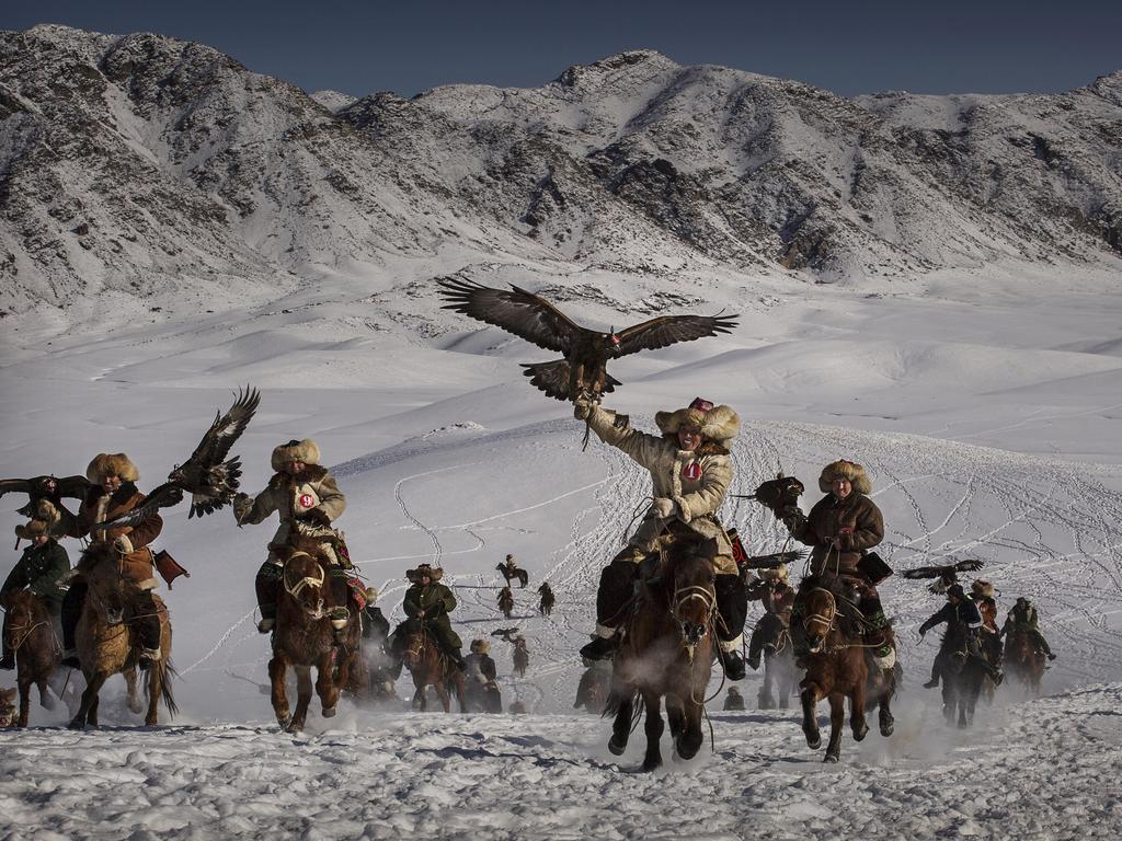 """The Eagle Hunting festival is part of an effort to promote and grow traditional hunting practices for new generations in the mountainous region of western China that borders Kazakhstan, Russia and Mongolia."" Picture: Kevin Frayer, Canada, Shortlist, Professional Environment, 2016 Sony World Photography Awards"