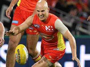 Cats player Patrick Dangerfield (left) competes with Suns player Gary Ablett during the Round 7 AFL match between the Gold Coast Suns and the Geelong Cats at Metricon Stadium in Carrara on the Gold Coast, Saturday, May 6, 2017. (AAP Image/Dave Hunt) NO ARCHIVING, EDITORIAL USE ONLY
