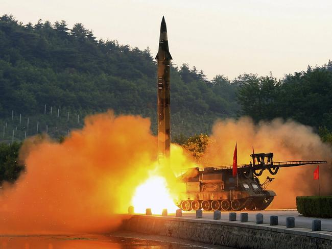 An undated photo shows the test-fire of a ballistic rocket equipped with precision guidance system, at an undisclosed location in North Korea.