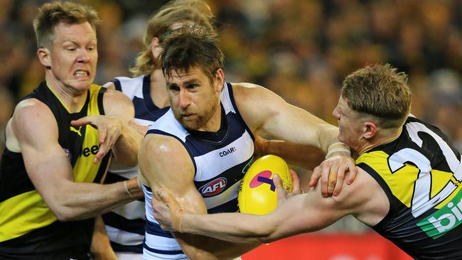 Geelong's Tom Lonergan under pressure from Jack Riewoldt and Josh Caddy. Picture: Mark Stewart
