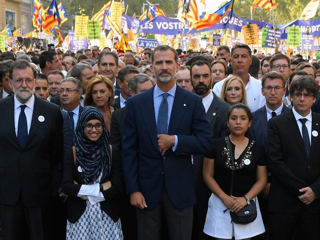 Spain's King Felipe VI (C) standing between Spanish Prime Minister Mariano Rajoy (L) and President of Catalonia Carles Puigdemont (R) during a march against terrorism. Picture: AFP