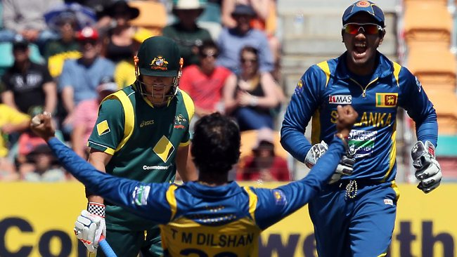 Tillakaratne Dilshan celebrates after bowling David Warner for 10. Picture: Leigh Winburn