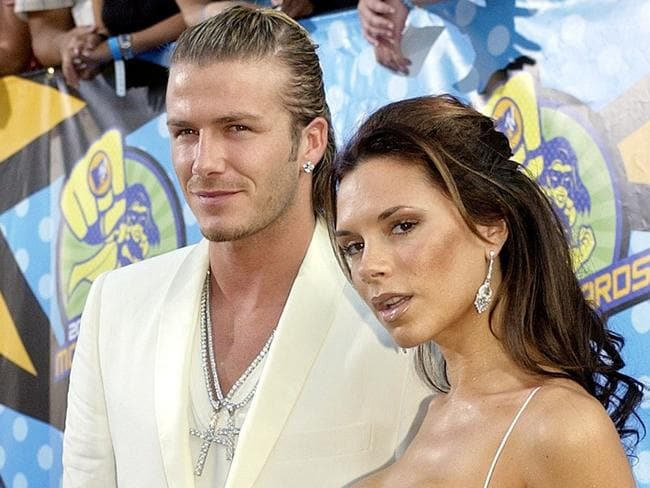 A blinged up Posh and Becks arrive for the MTV Movie Awards in 2003.