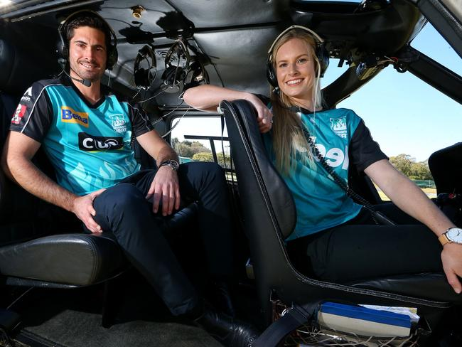 "Brisbane Heat cricket players Ben Cutting and Holly Ferling ""get to the chopper""."