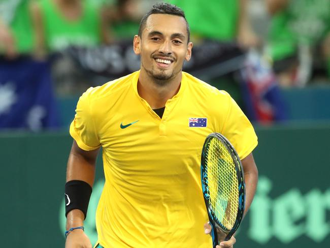 A smiling Kyrgios runs to his chair after a 'love' game. Picture: Darren England.