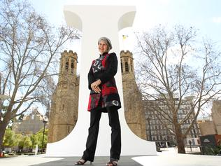 2011 Adelaide Festival of Ideas executive producer Sandy Verschoor with a giant, capital letter ''I'' outside University of Adelaide buildings.