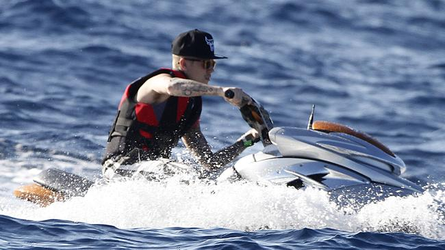 Justin Bieber enjoys jet skiing and swimming just hours after Orlando Bloom got into an altercation with Justin at a restaurant in Ibiza. Picture:Splash