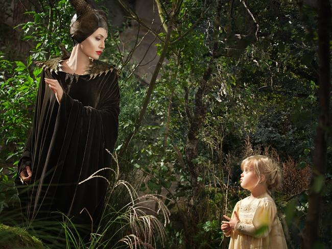 "Angelina Jolie as Maleficent, left, in a scene with her daughter Vivienne Jolie-Pitt, portraying Young Aurora, in a scene from the upcoming film ""Maleficent."""