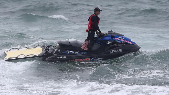 Two men were washed into the waters off Nobbys Beach. Picture: Peter Lorimer.
