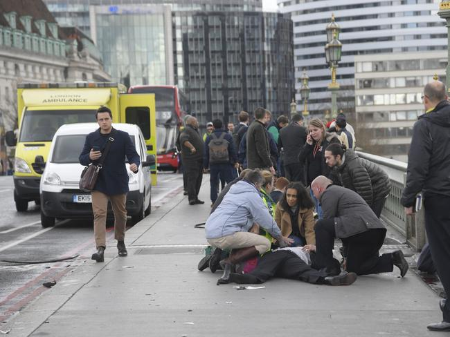 Injured people are assisted on Westminster Bridge in London. Picture: Reuters