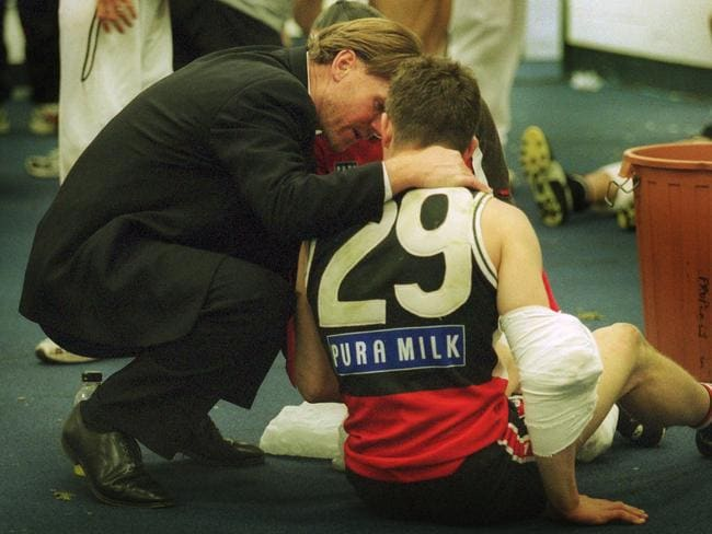 St Kilda president Rod Butterss with Steven Baker in the rooms after the loss.