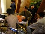 Grieving Chinese relatives of passengers on the missing Malaysia Airlines flight MH370 leave on a stretcher after being told of their deaths at the Metro Park Lido Hotel in Beijing. Picture: AFP PHOTO / Mark RALSTON