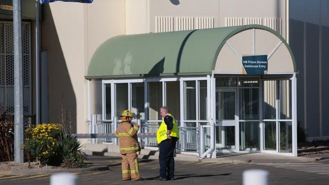 A fire officer and jail staffer outside HM Prison Barwon today. Picture: Peter Ristevski