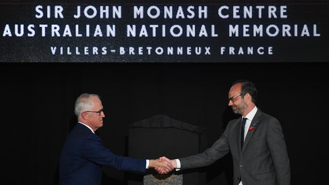 Prime Minister Malcolm Turnbull and French Prime Minister Edouard Philippe shake hands during the official opening of the Sir John Monash Centre at Villers-Bretonneux. Picture: AAP Image/Lukas Coch