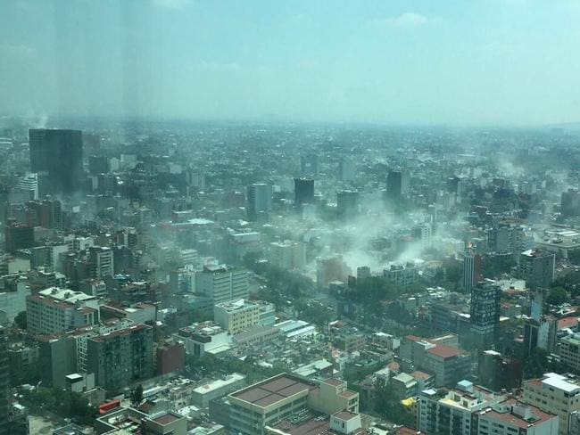 In this photo provided by Francisco Caballero Gout, shot through a window of the iconic Torre Latina, dust rises over down town Mexico City. Picture: AP / Francisco Caballero Gout