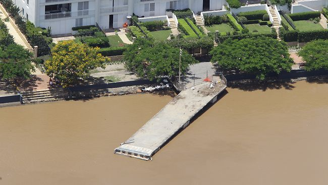 DEVASTATING COST: Brisbane'sTug boat pulls some of the floating walkway along - Photo - David Kapernick