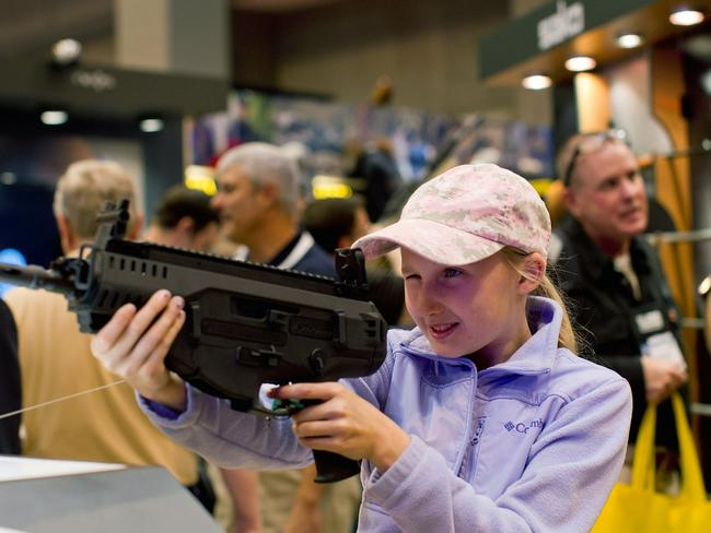 Take aim … Bailey Chappuis, 12, has a go with a Beretta ARX 160 during an NRA meetings last year in St Louis, Missouri. Picture: Whitney Curtis/Getty Images/AFP