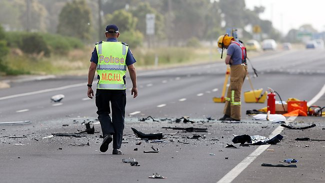 Emergency workers clean up the Princes Fwy after a head-on collision in Lara. Picture: Norm Oorloff