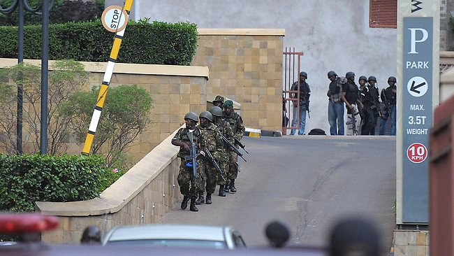 Military personel mobilise outside the upmarket shopping mall in Nairobi, where authoriteis say some shoppers and staff are still being held hostage by gunmen. Picture: AFP / Tony Karumba