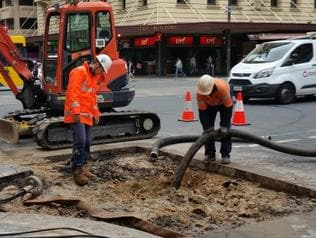 Supplied Editorial Burst water mains on Currie St and King William St intersection