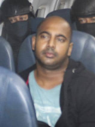 Nearing the end ... Bali Nine ringleader Myuran Sukumaran pictured on the plane as he is transferred from Bali to Cilacap, Java, and then Nusakambangan. Picture: Supplied