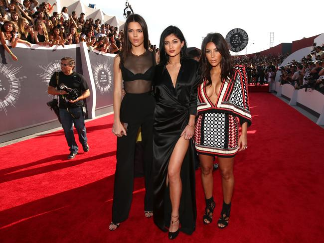 Storm of controversy ... Kendall Jenner, Kylie Jenner and Kim Kardashian on the red carpet for the MTV Video Music Awards at The Forum in Inglewood, California. Picture: Christopher Polk