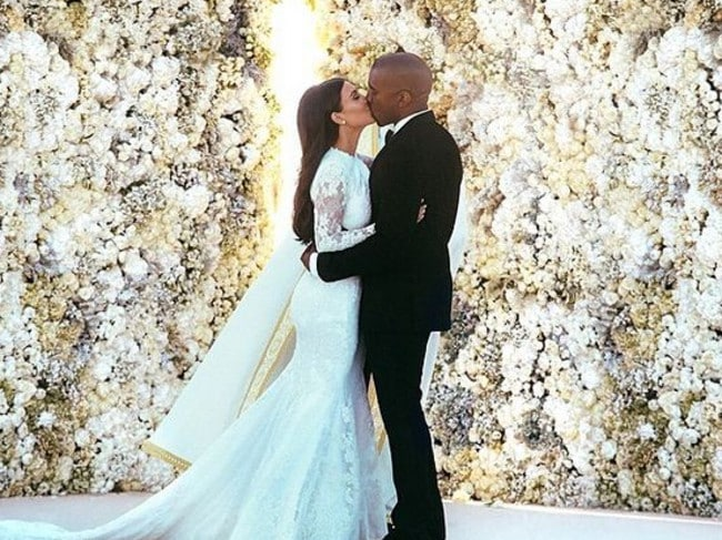 Kim and Kanye's first kiss as a married couple. Picture: Instagram/Kim Kardashian