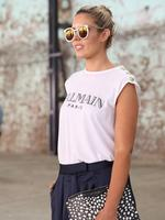 Elle Halliwell wearing Karen Walker sun glasses, Balmain t-shirt and a Givenchy clutch at Mercedes-Benz Fashion Week Australia 2015 at Carriageworks on April 13, 2015 in Sydney, Australia. Picture: Getty