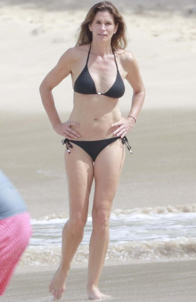 Naturally flawless. Cindy Crawford hits the beach at St Barths. Picture: Splash News Australia
